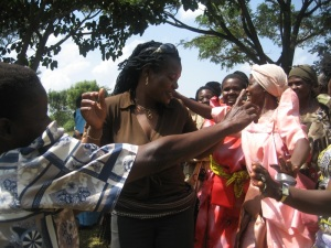 Idah dancing with grandmothers at PEFO