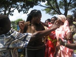 Idah dancing with grandmothers at PEFO
