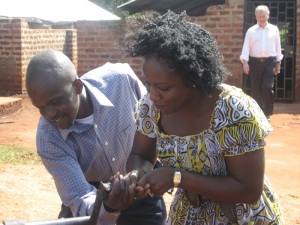 Justine helps Aissatou with the PEFO farm school well