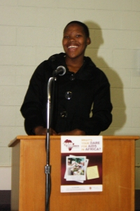 Nkulie speaking at an AfriGrand Caravan event in Summerside, PEI