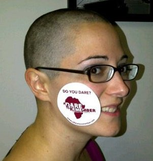 Brandy bald wearing a Dare sticker